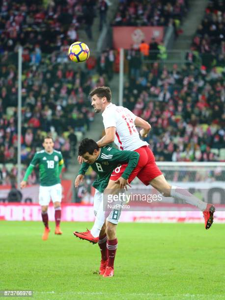 Hirving Lozano and Pawel Wszolek during the international friendly soccer match between Poland and Mexico at the Energa Stadium in Gdansk Poland on...