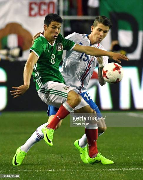 Hirving Lozano of Mexico and Vidar Ari Jonsson of Iceland go after the ball during their exhibition match at Sam Boyd Stadium on February 8 2017 in...