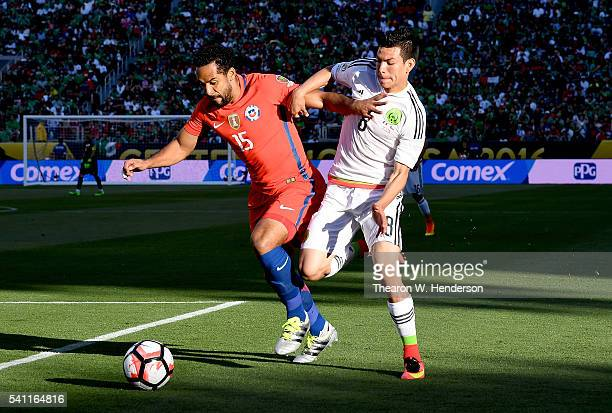 Hirving Lozano of Mexico battles for control of the ball with Jean Beausejour of Chile during the 2016 Copa America Centenario Quarterfinals match...