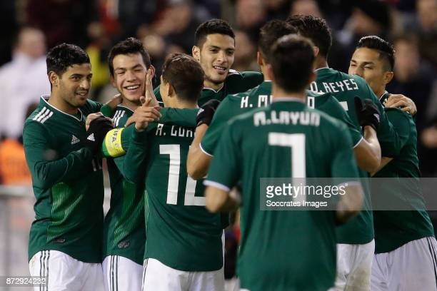 Hirving Lozano of Mexico celebrate 23 with Carlos Vela of Mexico Andres Guardado of Mexico during the International Friendly match between Belgium v...