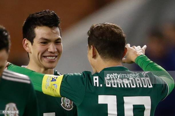 Hirving Lozano of Mexico celebrates 23 with Andres Guardado of Mexico during the International Friendly match between Belgium v Mexico at the Koning...