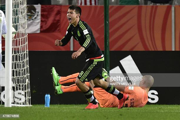 Hirving Lozano of Mexico celebrates scoring a goal past Uruguay's goalkeeper Gaston Guruceaga during the FIFA Under20 World Cup football match...