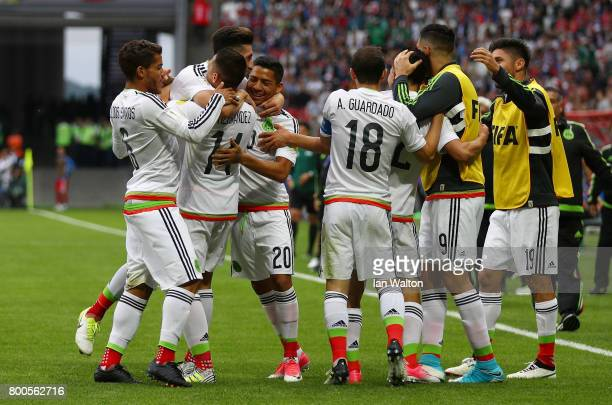 Hirving Lozano of Mexico celebrates scoring his sides second goal with his Mexico team mates during the FIFA Confederations Cup Russia 2017 Group A...