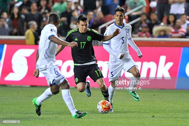 Hirving Lozano of Mexico controls the ball between Bryan Acosta and Allans Vargas both of Honduras in the second half of the final CONCACAF Olympic...
