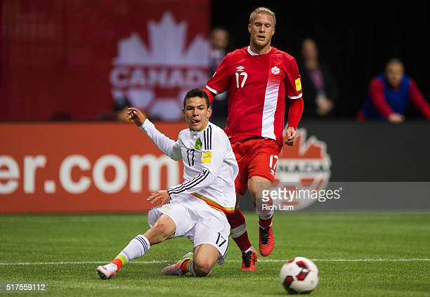Hirving Lozano of Mexico crosses the ball after getting past Marcel De Jong of Canada during FIFA 2018 World Cup Qualifier soccer action at BC Place...