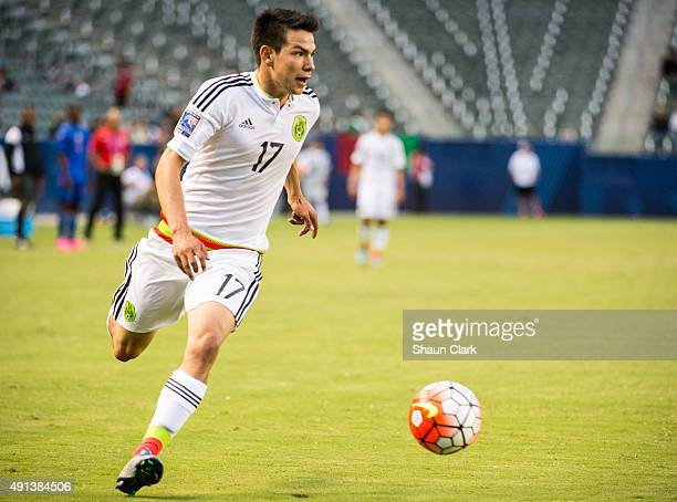 Hirving Lozano of Mexico dribbles toward goal during Mexico's Olympic Qualifying match against Haiti at the StubHub Center on October 4 2015 in...