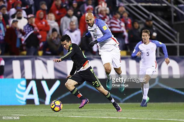 Hirving Lozano of Mexico fights for the ball with John Brooks of USA during the match between USA and Mexico as part of FIFA 2018 World Cup...