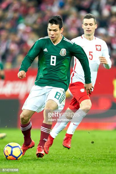 Hirving Lozano of Mexico fights for the ball with Krzysztof Maczynski of Poland during the International Friendly match between Poland and Mexico at...