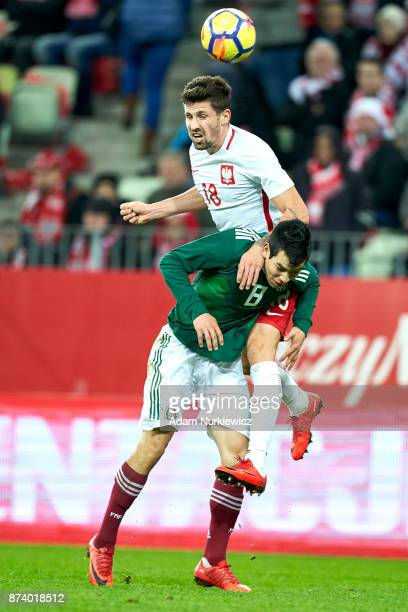 Hirving Lozano of Mexico fights for the ball with Pawel Wszolek of Poland during the International Friendly match between Poland and Mexico at Energa...