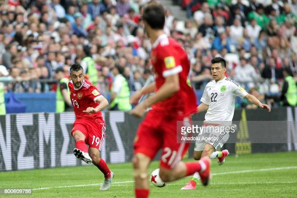 Hirving Lozano of Mexico in action against Alexander Samedov of Russia during the FIFA Confederations Cup 2017 group A soccer match between Mexico...