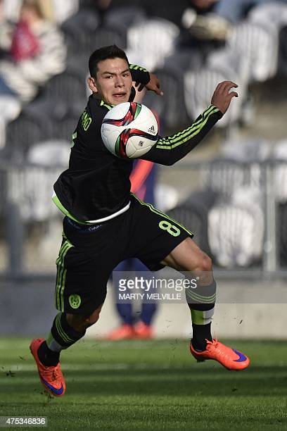 Hirving Lozano of Mexico makes a pass during the FIFA Under20 World Cup football match between Mexico and Mali in Dunedin on May 31 2015 AFP PHOTO /...
