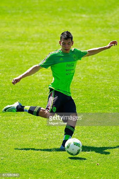 Hirving Lozano of Mexico prepares to kick the ball during a training session ahead of the friendly match between Mexico and Argentina at CAR on July...