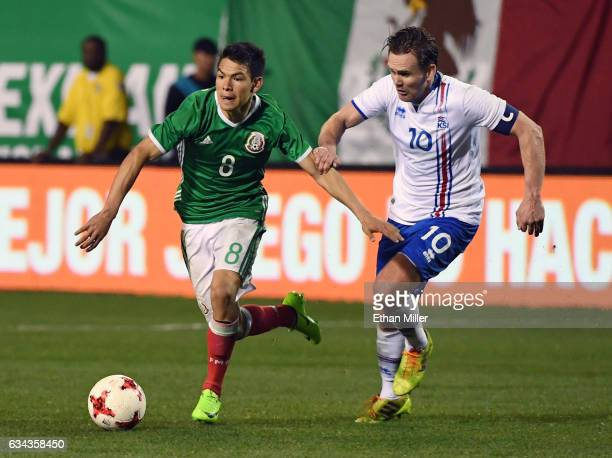 Hirving Lozano of Mexico runs with the ball ahead of David Thor Vidarsson of Iceland during their exhibition match at Sam Boyd Stadium on February 8...