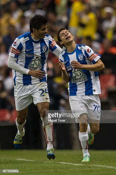 Hirving Lozano of Pachuca celebrates after scoring with teammate Miguel Herrera during a match between America and Pachuca as part of the Clausura...