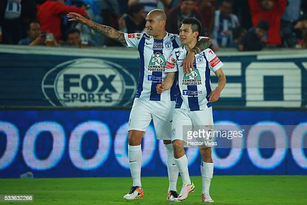 Hirving Lozano of Pachuca celebrates with teammates after scoring the second goal of his team during the semi finals first leg match between Pachuca...