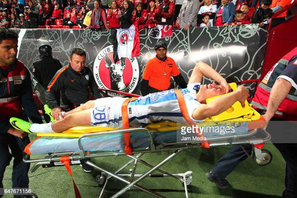 Hirving Lozano of Pachuca is taken out of the game because of an injury during the 9th round match between Tijuana and Monterrey as part of the...