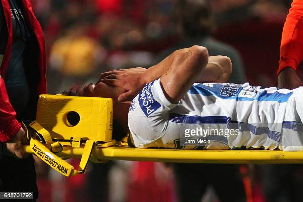 Hirving Lozano of Pachuca leaves the field injured during the 9th round match between Tijuana and Monterrey as part of the Torneo Clausura 2017 Liga...