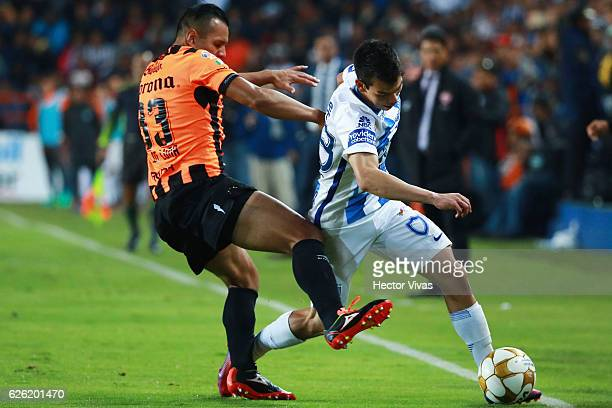 Hirving Lozano of Pachuca struggles for the ball with Mario de Luna of Necaxa during the quarter finals second leg match between Pachuca and Necaxa...