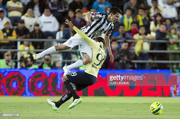 Hirving Lozano of Pachuca vies for the ball with Daniel Vazquez of America during their Mexican Clausura tournament football match at the Hidalgo...