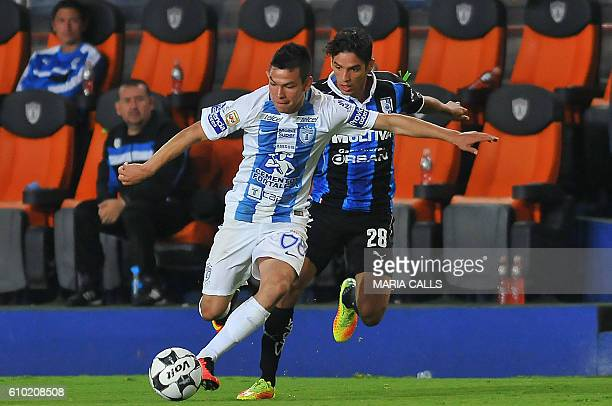 Hirving Lozano of Pachuca vies for the ball with Jaime Gomez of Queretaro during their Mexican Clausura 2016 Tournament football match at Hidalgo...