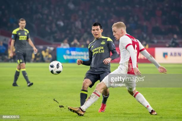 Hirving Lozano of PSV Donny van de Beek of Ajax during the Dutch Eredivisie match between Ajax Amsterdam and PSV Eindhoven at the Amsterdam Arena on...