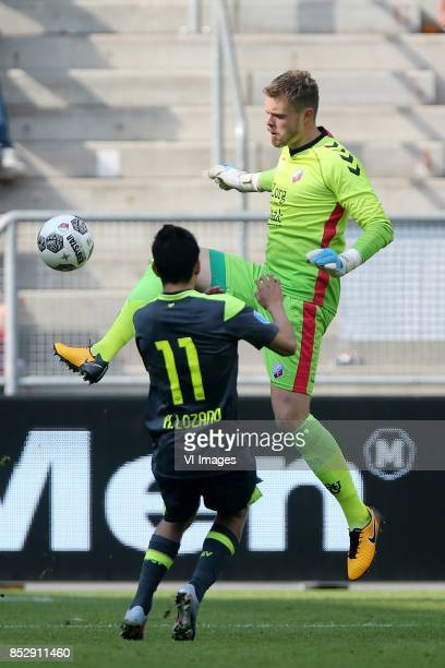 Hirving Lozano of PSV goalkeeper David Jenssen of FC Utrecht during the Dutch Eredivisie match between FC Utrecht and PSV Eindhoven at the...