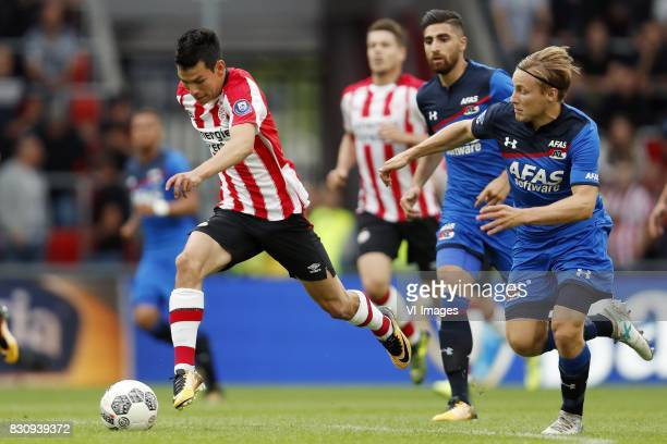 Hirving Lozano of PSV Marco van Ginkel of PSV Alireza Jahanbakhsh of AZ Jonas Svensson of AZ during the Dutch Eredivisie match between PSV Eindhoven...