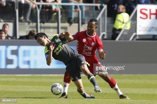 Hirving Lozano of PSV Mark van der Maarel of FC Utrecht during the Dutch Eredivisie match between FC Utrecht and PSV Eindhoven at the Galgenwaard...