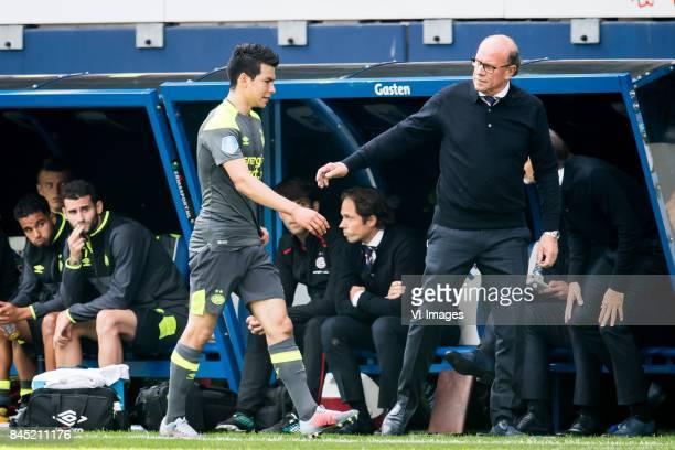 Hirving Lozano of PSV Mart van den Heuvel during the Dutch Eredivisie match between sc Heerenveen and PSV Eindhoven at Abe Lenstra Stadium on...