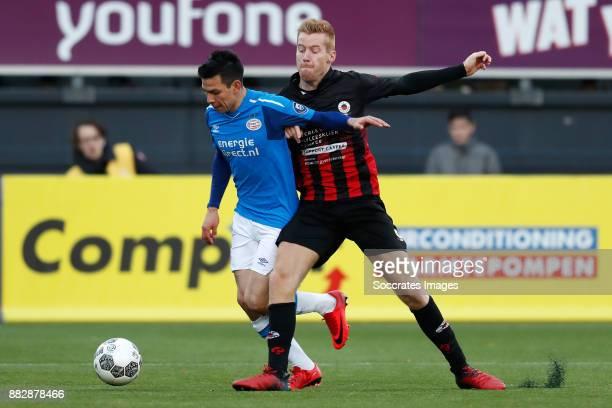 Hirving Lozano of PSV Mike van Duinen of Excelsior during the Dutch Eredivisie match between Excelsior v PSV at the Van Donge De Roo Stadium on...