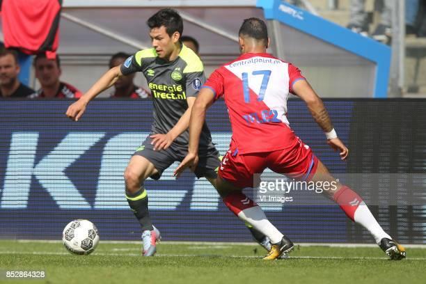 Hirving Lozano of PSV Sean Klaiber of FC Utrecht during the Dutch Eredivisie match between FC Utrecht and PSV Eindhoven at the Galgenwaard Stadium on...