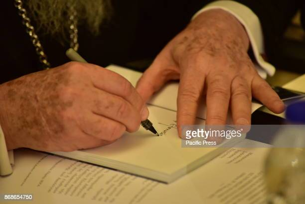 HOTEL ATHENS ATTIKI GREECE His All Holiness Bartholomew Archibishop of Constantinople New Rome and Ecumenical Patriarch put his signature in a book