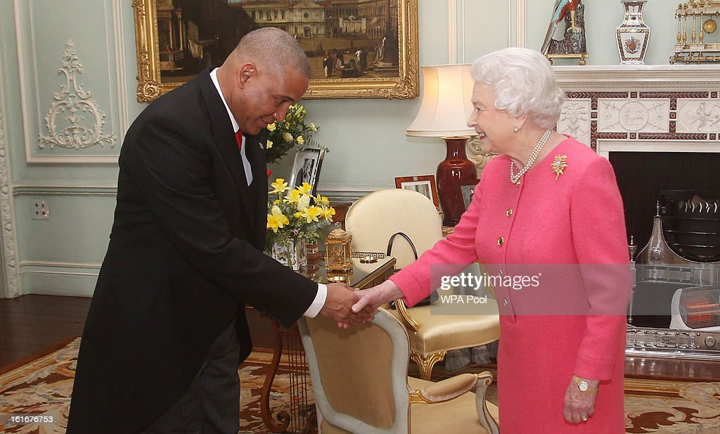 His Excellency Dr. Ernest Hilaire is received in audience by Queen <a gi-track='captionPersonalityLinkClicked' href=/galleries/search?phrase=Elizabeth+II&family=editorial&specificpeople=67226 ng-click='$event.stopPropagation()'>Elizabeth II</a> at Buckingham Palace upon his appointment as High Commissioner for St. Lucia on February 14, 2013 in London, England.