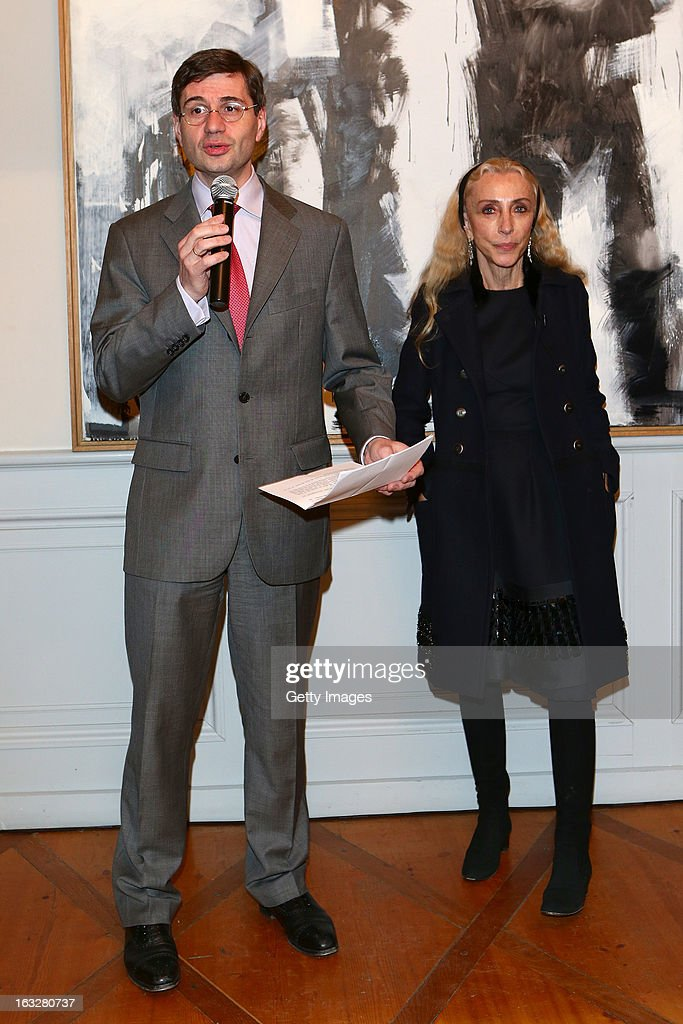 His Excellency Mr. Nicolas Niemtchinow France Ambassador to Switzerland delivers a speech as <a gi-track='captionPersonalityLinkClicked' href=/galleries/search?phrase=Franca+Sozzani&family=editorial&specificpeople=639425 ng-click='$event.stopPropagation()'>Franca Sozzani</a>, Vogue Italia Editor in Chief, during the charity auctioning of the first 'Citroen DS3 Cabrio L'Uomo Vogue' hosted by L'Uomo Vogue and Citroen at the Permanent Mission of France to the United Nations Office on March 6, 2013 in Geneva, Switzerland.