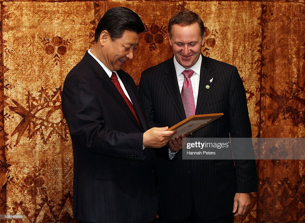 His Excellency Mr Xi Jinping, Vice President of the People's Republic of China is presented with a photo from Prime Minister John Key after talks at Government House during the second day of his three day visit to New Zealand on June 18, 2010 in Auckland, New Zealand. The visit is intended to enhance economical and political relations between China and New Zealand following the signing of a free-trade agreement in 2008.
