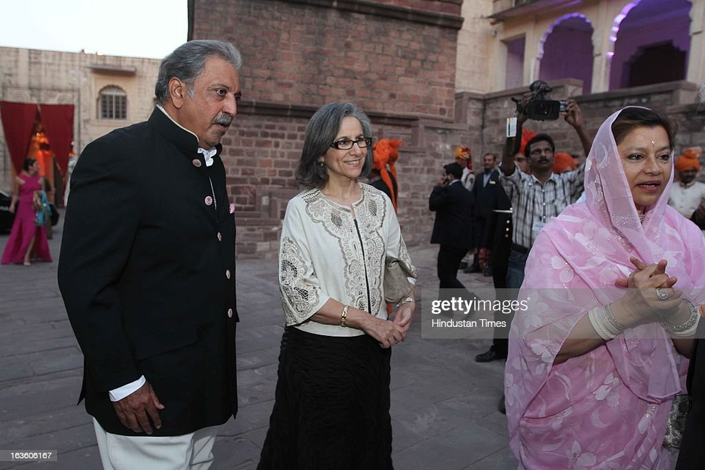 His Highness Gaj Singh II and his wife Hemlata Rajye (L) with a guest during a party at the Mehrangarh Fort on March 8, 2013 in Jodhpur, India.