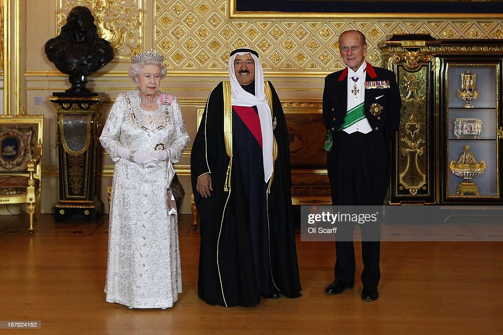 His Highness the Amir Sheikh Sabah Al-Ahmad Al-Jaber Al-Sabah of Kuwait (C) poses with Queen <a gi-track='captionPersonalityLinkClicked' href=/galleries/search?phrase=Elizabeth+II&family=editorial&specificpeople=67226 ng-click='$event.stopPropagation()'>Elizabeth II</a> and <a gi-track='captionPersonalityLinkClicked' href=/galleries/search?phrase=Prince+Philip&family=editorial&specificpeople=92394 ng-click='$event.stopPropagation()'>Prince Philip</a>, the Duke of Edinburgh in Windsor Castle on November 27, 2012 in Windsor, England. The Amir of Kuwait is conducting three-day state visit to the UK; tomorrow he will meet with British Prime Minister David Cameron in Downing Street and attend a Banquet at the Guildhall.