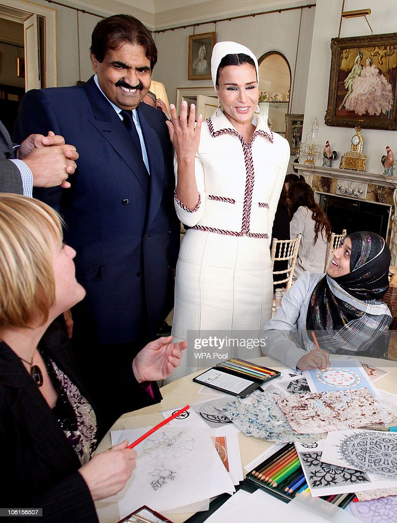 His Highness the Emir of the State of Qatar, Sheikh Hamad bin Khalifa Al Thani and his wife, Sheikha Mozah bint Nasser Al-Missned share a smile with students of His Royal Highness Prince Charles' School of Traditional Arts on 27 October, 2010 in London, England. Sheikh Hamad bin Khalifa al-Thani and his wife are on a three-day state visit to the UK and are due to visit the 2012 Olympics site later today.