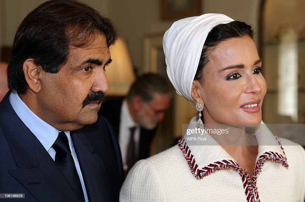 His Highness the Emir of the State of Qatar, Sheikh Hamad bin Khalifa Al Thani and his wife Sheikha Mozah bint Nasser Al-Missned walk together after visiting students from His Royal Highness Prince Charles' School of Traditional Arts at Clarence House on 27 October, 2010 in London, England. Sheikh Hamad bin Khalifa al-Thani and his wife are on a three-day state visit to the UK and are due to visit the 2012 Olympics site later today.