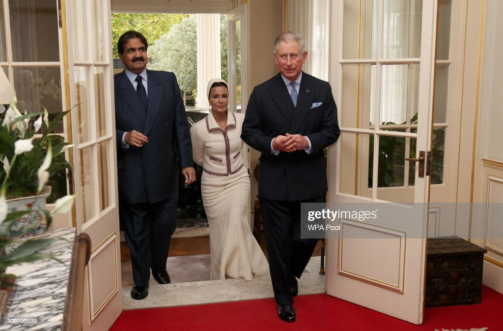 His Highness the Emir of the State of Qatar, Sheikh Hamad bin Khalifa Al Thani and his wife, Sheikha Mozah bint Nasser Al-Missned follow <a gi-track='captionPersonalityLinkClicked' href=/galleries/search?phrase=Prince+Charles&family=editorial&specificpeople=160180 ng-click='$event.stopPropagation()'>Prince Charles</a>, Prince of Wales into Clarence House prior to meeting students from His Royal Highness <a gi-track='captionPersonalityLinkClicked' href=/galleries/search?phrase=Prince+Charles&family=editorial&specificpeople=160180 ng-click='$event.stopPropagation()'>Prince Charles</a>' School of Traditional Arts on 27 October, 2010 in London, England. Sheikh Hamad bin Khalifa al-Thani and his wife are on a three-day state visit to the UK and are due to visit the 2012 Olympics site later today.