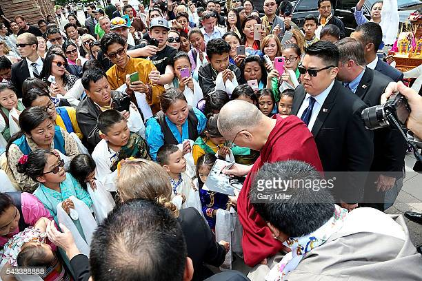 His Holiness the 14th Dalai Lama greets followers on his arrival to the St Julien Hotel Spa on June 23 2016 in Boulder Colorado