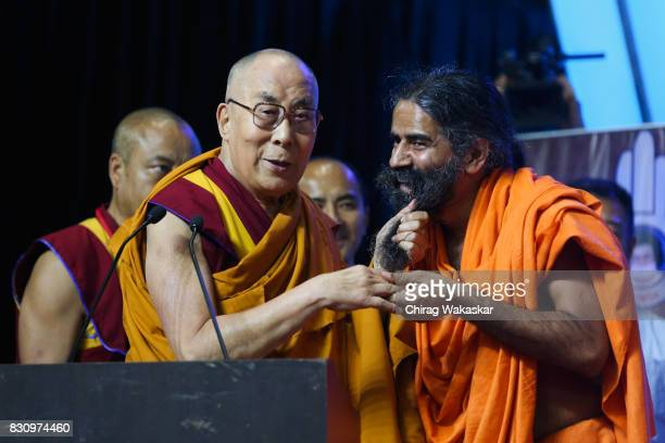 His Holiness The 14th Dalai Lama with Yoga guru Baba Ramdev World Peace Harmony Conclave at NSCI Dome on August 13 2017 in Mumbai India