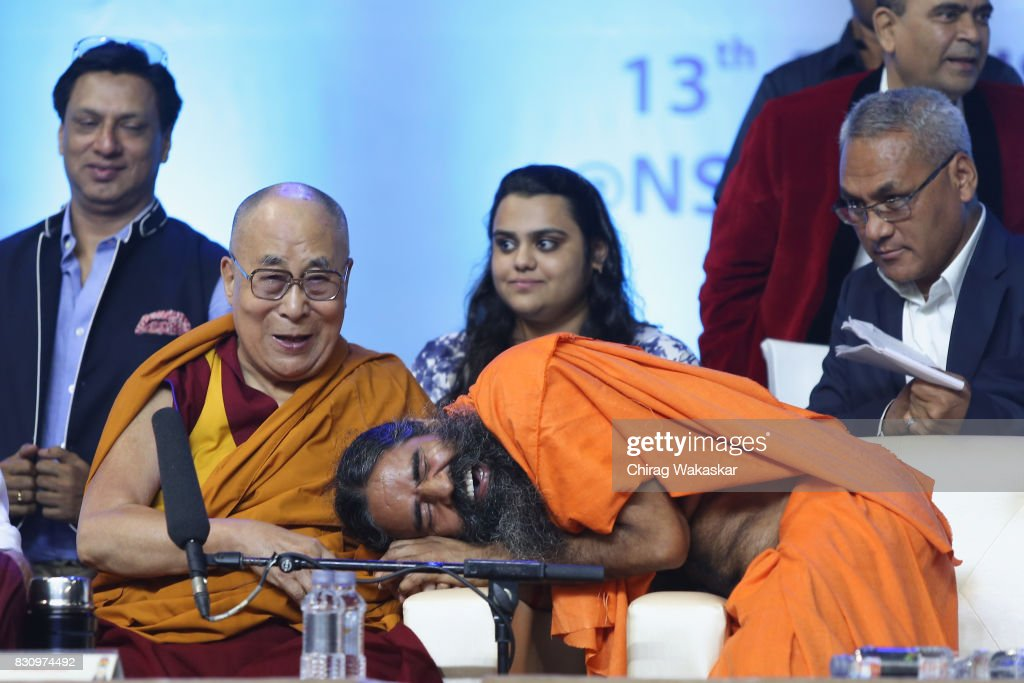 His Holiness The 14th Dalai Lama (L) with Yoga guru Baba Ramdev (R) World Peace & Harmony Conclave at NSCI Dome on August 13, 2017 in Mumbai, India.