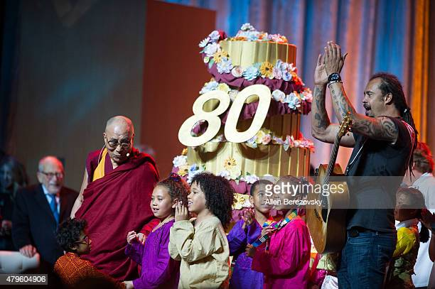 His Holiness the Dalai Lama and recording artist Michael Franti celebrate onstage during His Holiness the 14th Dalai Lama's 80th birthday and Global...