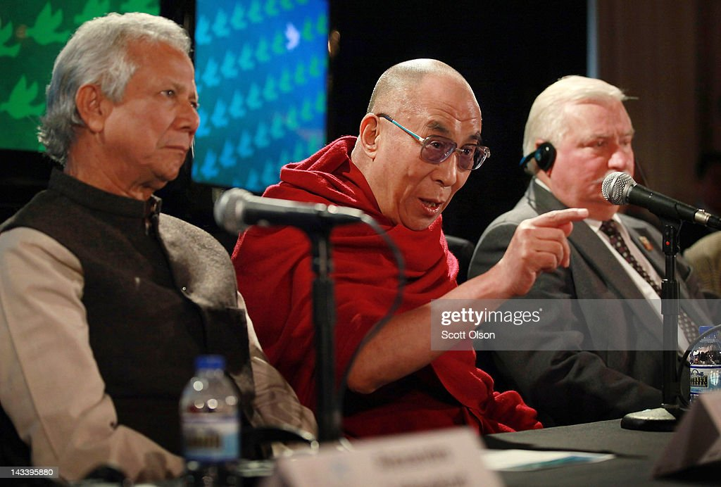 His Holiness the Dalai Lama answers questions during a press conference flanked by Professor Muhammed Yunus (L) and former Polish President <a gi-track='captionPersonalityLinkClicked' href=/galleries/search?phrase=Lech+Walesa&family=editorial&specificpeople=93677 ng-click='$event.stopPropagation()'>Lech Walesa</a> (R) at the World Summit of Nobel Peace Laureates at the Chicago Symphony Orchestra Hall on April 25, 2012 in Chicago, Illinois. The 12th World Summit of Nobel Peace Laureates ends today following three days of events.