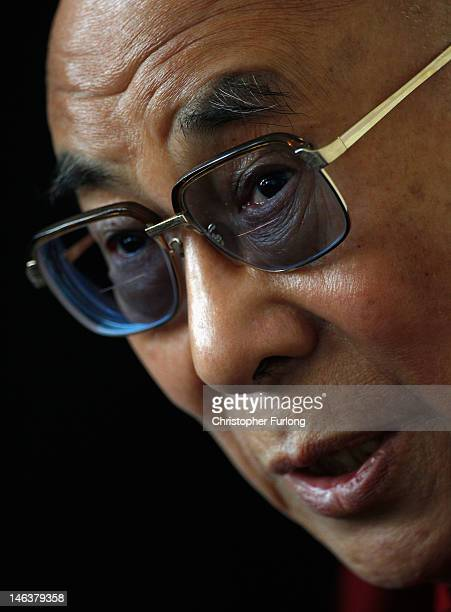 His Holiness the Dalai Lama answers questions from the media during a press conference at The Lowry Hotel on June 15 2012 in Manchester England The...
