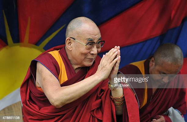 His holiness the Dalai Lama attends the third day of Glastonbury Festival at Worthy Farm Pilton on June 28 2015 in Glastonbury England