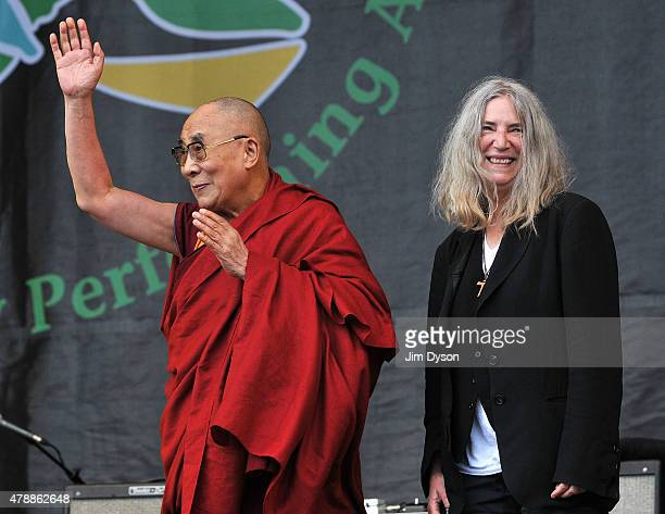 His holiness the Dalai Lama joins Patti Smith on the Pyramid stage during the third day of Glastonbury Festival at Worthy Farm Pilton on June 28 2015...