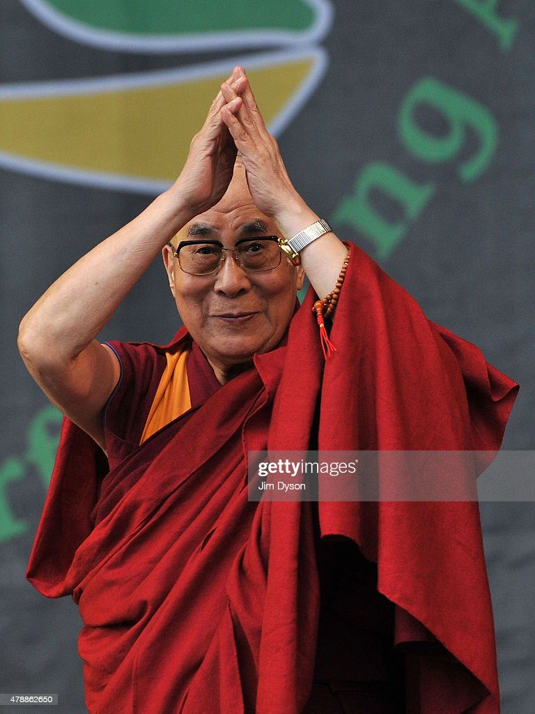 His holiness the Dalai Lama joins Patti Smith on the Pyramid stage during the third day of Glastonbury Festival at Worthy Farm, Pilton on June 28, 2015 in Glastonbury, England.