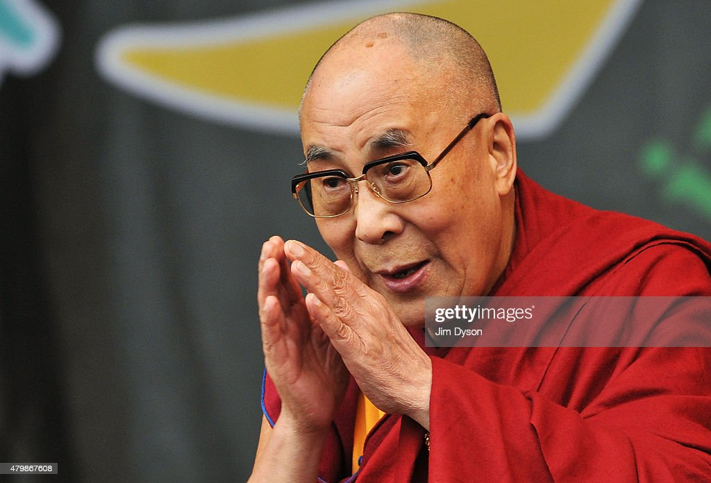His holiness the Dalai Lama joins Patti Smith on the Pyramid stage during the third day of the Glastonbury Festival at Worthy Farm, Pilton on June 28, 2015 in Glastonbury, England.